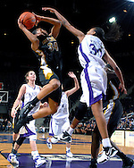 Missouri guard Tiffany Brooks (34) drives to the basket under pressure from Kansas State's Shana Wheeler (30) during the first half at Bramlage Coliseum in Manhattan, Kansas, January 13, 2007.  K-State beat the Tigers 81-66.
