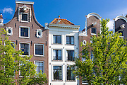 Typical Dutch architecture houses along Herengracht canalside street in Amsterdam, Holland