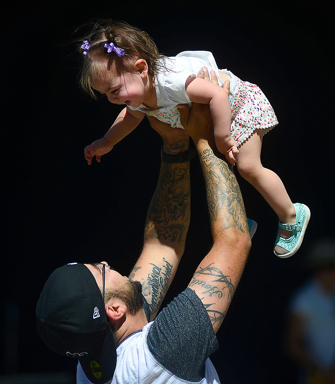 apl061817d/ASECTION /pierre-louis/JOURNAL 061817<br /> Matthew Garcia,, and his 1 year-old daughter Mia Garcia,, dance to the music of Country star Frankie Ballard while the pair enjoys Father's Day at the Zoo .Photographed  on Sunday June  18,  2017. .Adolphe Pierre-Louis/JOURNAL
