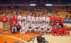 Poca poses for a picture after winning the Class AA championship game at the Charleston Civic Center.