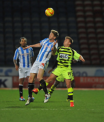 Huddersfield Town's Jonathan Stead wins high ball from Yeovil Town's Sam Hoskins - Photo mandatory by-line: Alex James/JMP - Tel: Mobile: 07966 386802 29/12/2013 - SPORT - FOOTBALL - John Smith's Stadium - Huddersfield - Huddersfield Town v Yeovil Town - Sky Bet Championship