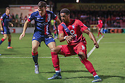 Doncaster Rovers midfielder Harry Middleton closes down York City forward Vadaine Oliver during the Johnstone's Paint Trophy match between York City and Doncaster Rovers at Bootham Crescent, York, England on 6 October 2015. Photo by Simon Davies.