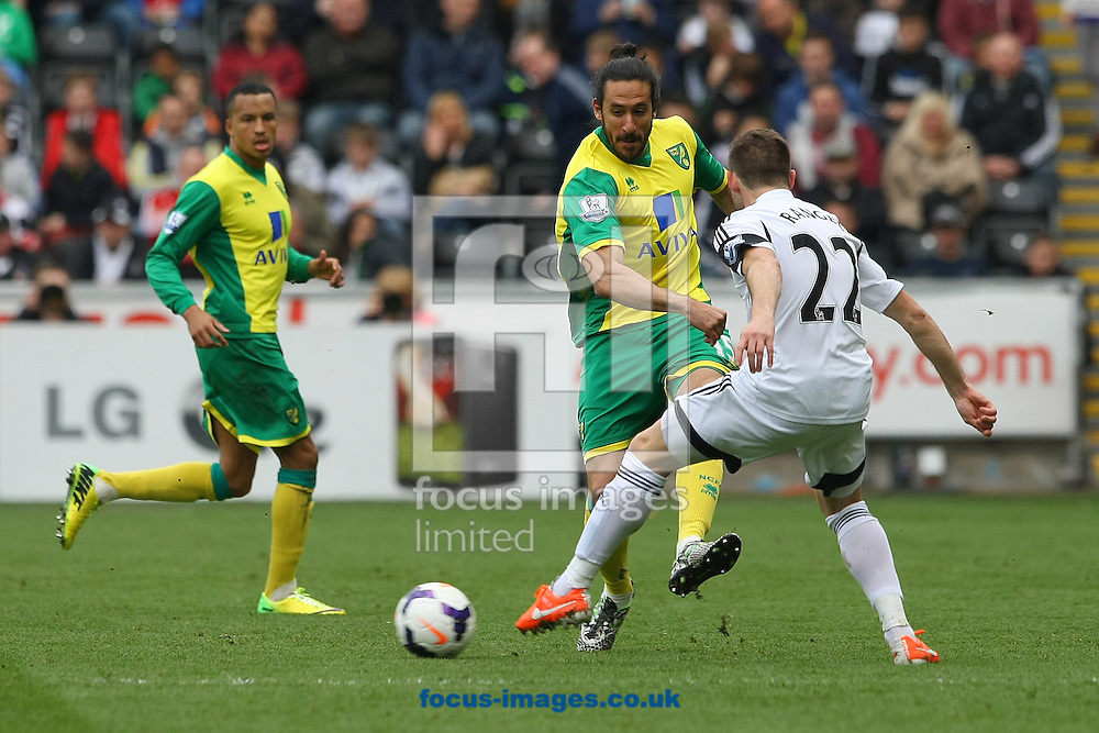 Jonas Gutierrez of Norwich and Angel Rangel of Swansea in action during the Barclays Premier League match at the Liberty Stadium, Swansea<br /> Picture by Paul Chesterton/Focus Images Ltd +44 7904 640267<br /> 29/03/2014
