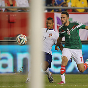 Nani, (left), Portugal, gets in a cross while challenged by Miguel Layún, Mexico, during the Portugal V Mexico International Friendly match in preparation for the 2014 FIFA World Cup in Brazil. Gillette Stadium, Boston (Foxborough), Massachusetts, USA. 6th June 2014. Photo Tim Clayton