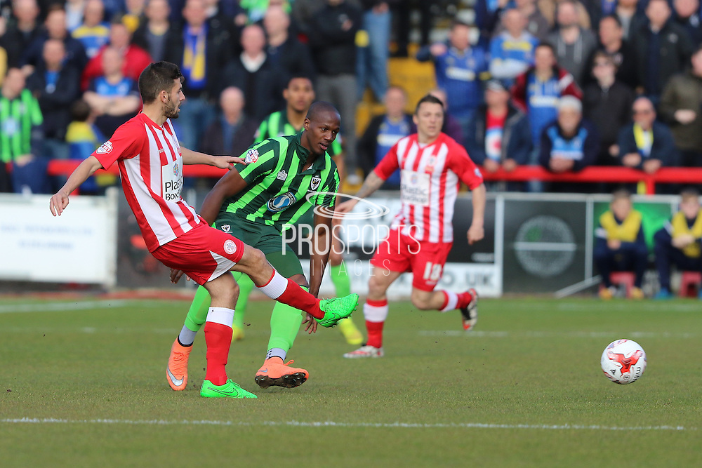 Tom Elliott forward for AFC Wimbledon (9) and Adam Buxton defender Accrington Stanley (22) during the Sky Bet League 2 play-off 2nd leg match between Accrington Stanley and AFC Wimbledon at the Fraser Eagle Stadium, Accrington, England on 18 May 2016. Photo by Stuart Butcher.