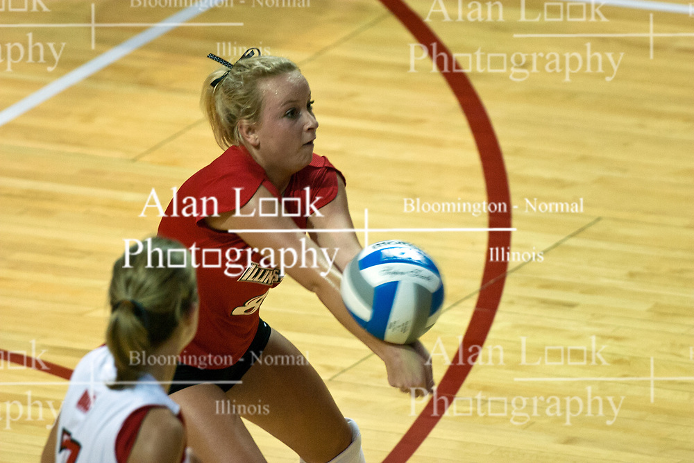 19 AUG 2006  Libero Kasey Mollerus two fists a return. Northern Illinois Huskies got slammed by Illinois State Redbirds, losing the match 3 games to 1. Game action took place at Redbird Arena on the campus of Illinois State University in Normal Illinois.