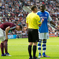 Hearts v St Johnstone...04.08.12<br /> Gregory Tade appeals to ref Stevie O'Reilly before being sent off<br /> Picture by Graeme Hart.<br /> Copyright Perthshire Picture Agency<br /> Tel: 01738 623350  Mobile: 07990 594431