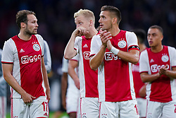 13-08-2019 NED: UEFA Champions League AFC Ajax - Paok Saloniki, Amsterdam<br />  Ajax won 3-2 and they will meet APOEL in the battle for a group stage spot / Daley Blind #17 of Ajax, Dusan Tadic #10 of Ajax, Donny van de Beek #6 of Ajax