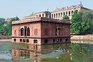 The Red Fort, located in the center of Delhi, was constructed in 1648 by the fifth Mughal Emperor Shan Jahan as the palace of his fortified capital.  It was the residence of the Mughal emporor until 1857.  In year 2007, it was designated a UNESCO World Heritage Site.