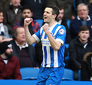 Brighton player Jamie Murphy celebrates after opening the scoring during the Sky Bet Championship match between Brighton and Hove Albion and Bolton Wanderers at the American Express Community Stadium, Brighton and Hove, England on 13 February 2016. Photo by Bennett Dean.