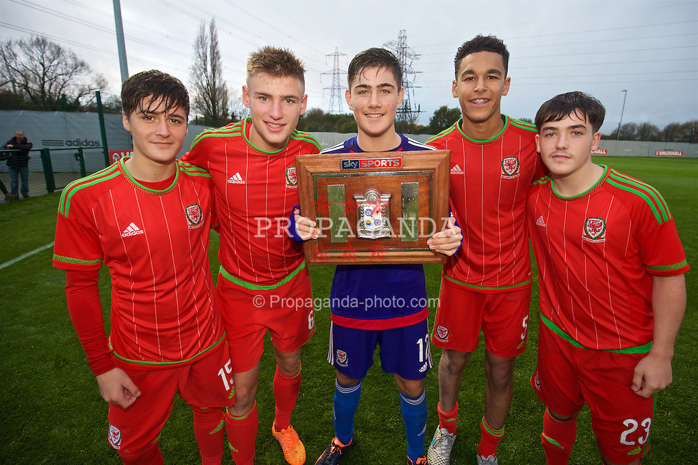 NEWPORT, WALES - Thursday, November 5, 2015: Wales' Mason Jones-Thomas, Brandon Cooper, goalkeeper Scott Reed, Benjamin Cabango and Mathew Jake Nicholls celebrate with the Victory Shield after a 3-1 victory over Northern Ireland during the Under-16's Victory Shield International match at Dragon Park. (Pic by David Rawcliffe/Propaganda)