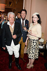 Left to right, NICKY HASLAM, JOHNNY CORNWELL and HANNAH BETTS at a private view of fashion art by David Downton as in-house artist at Caridge's , held at Claridge's Hotel, London on 13th September 2013.