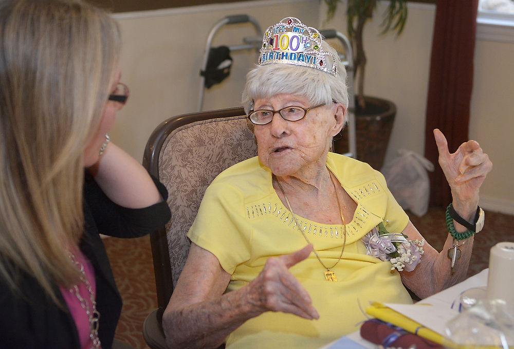 gbs072717i/LIFE  -- Rosalyn Zimmerman of Albuquerque  talks with her granddaughter Sara Penn of Albuquerque during her 100th birthday party at Atria Vista del Rio assisted living facility on Thursday, July 27, 2017. (Greg Sorber/Albuquerque Journal)