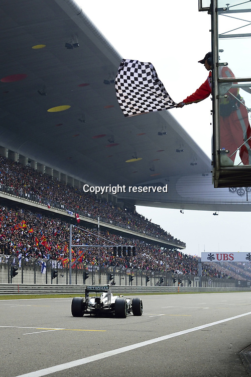 20.04.2014. SHanghai, China.  Motorsports: FIA Formula One World Championship 2014, Grand Prix of China, 44 Lewis Hamilton (GBR, Mercedes AMG Petronas F1 Team) takes the chequered flag in winning the race