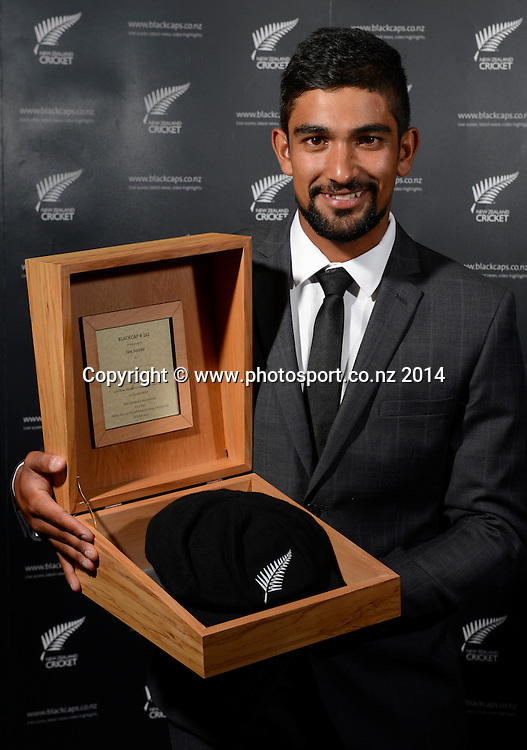 Ish Sodhi poses for a picture with his Test Cap at the 2013/14 New Zealand Cricket Annual Awards dinner at the Langham Hotel in Auckland, New Zealand. Photo: Andrew Cornaga/www.Photosport.co.nz