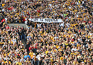 October 23 2010: Iowa fans hold up a sign for Iowa defensive coordinator Norm Parker who is in the hospital during the first half of the NCAA football game between the Wisconsin Badgers and the Iowa Hawkeyes at Kinnick Stadium in Iowa City, Iowa on Saturday October 23, 2010. Wisconsin defeated Iowa 31-30.