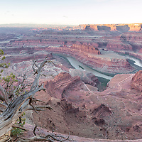 The rising sun illuminates the canyons of Dead Horse Point State Park, near Moab, Utah