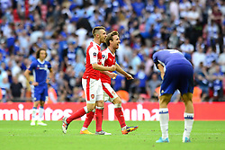 Aaron Ramsey of Arsenal and Nacho Monreal celebrate beating Chelsea 2-1 in the FA Cup final  - Mandatory by-line: Dougie Allward/JMP - 27/05/2017 - FOOTBALL - Wembley Stadium - London, England - Arsenal v Chelsea - Emirates FA Cup Final
