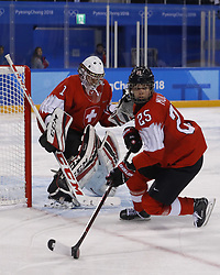 February 18, 2018 - Pyeongchang, KOREA - Switzerland forward Alina Muller (25) and Switzerland goaltender Janine Alder (1) in a hockey game between Switzerland and Korea during the Pyeongchang 2018 Olympic Winter Games at Kwandong Hockey Centre. Switzerland beat Korea 2-0. (Credit Image: © David McIntyre via ZUMA Wire)