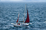 Sailboat in the Minch strait off Neist Point of Isle of Skye, Scotland, United Kingdom, Europe.