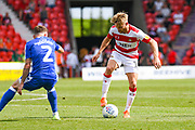 Alfie May of Doncaster Rovers (19) in action during the EFL Sky Bet League 1 match between Doncaster Rovers and Gillingham at the Keepmoat Stadium, Doncaster, England on 3 August 2019.