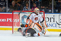 KELOWNA, CANADA - NOVEMBER 25: A player collides into the net of Michael Bullion #30 of the Medicine Hat Tigers against the Kelowna Rockets on November 25, 2017 at Prospera Place in Kelowna, British Columbia, Canada.  (Photo by Marissa Baecker/Shoot the Breeze)  *** Local Caption ***