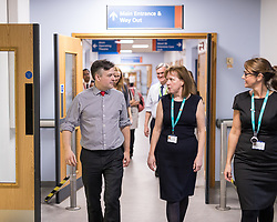 © Licensed to London News Pictures. 26/01/2018. Lancaster, UK. Shadow Health Secretary JONATHAN ASHWORTH MP (l) and Lancaster and Fleetwood MP CAT SMITH (r) walk through corridors , during a visit Lancaster Royal Infirmary and tour Accident and Emergency and the wards on a day when the A&E department at the hospital was at 100% of capacity with no spare cubicles . Labour say the NHS is in crisis in the North West with patients waiting in ambulances outside hospitals for over an hour and hospitals running out of beds. Photo credit: Joel Goodman/LNP