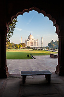 The Taj Mahal as seen from an angle off to the side through cusped archway, Agra, Uttar Pradesh,  India.