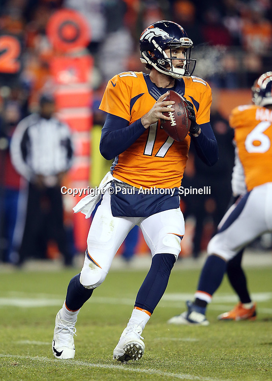 Denver Broncos quarterback Brock Osweiler (17) rolls out as he looks to pass during the 2015 NFL week 16 regular season football game against the Cincinnati Bengals on Monday, Dec. 28, 2015 in Denver. The Broncos won the game in overtime 20-17. (©Paul Anthony Spinelli)