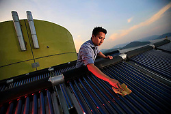 CHINA HONG KONG 24MAY10 - Sustainability officer Calvin Lee Kwan maintains a pilot solar thermal water heating installation at Hong Kong's Science and Technology University...jre/Photo by Jiri Rezac / The Climate Group..© Jiri Rezac 2010