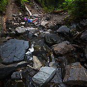 Heather Goodrich crashes head first into boulders while riding a river crossing in Seward, Alaska.
