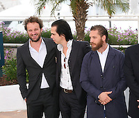 Jason Clarke, Nick Cave, Tom Hardy at the Lawless film photocall at the 65th Cannes Film Festival. The screenplay for the film Lawless was written by Nick Cave and Directed by John Hillcoat. Saturday 19th May 2012 in Cannes Film Festival, France.