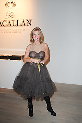 Actress & singer CLARE GROGAN at a private view of Masters of Photography - A Journey presented by Macallan and Albert Watson held at Philips De Pury, Howick Place, London SW1 on 1st December 2010.