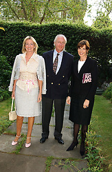 Left to right, HILARY & GALEN WESTON and VICTORIA, LADY DE ROTHSCHILD at a Conservative Party summer garden party hosted by Lord Hesketh and held at 7 Lansdowne Road, Notting Hill, London W11 on 28th June 2004.