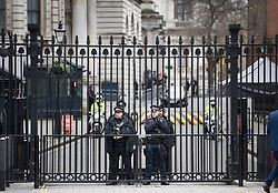 © Licensed to London News Pictures. 06/12/2017. London, UK. Police stand guard at the gates of Downing Street. Yesterday a plot to attack the gates of Downing Street and kill Mrs May was revealed. Two men have appeared in court this morning.  Photo credit: Peter Macdiarmid/LNP