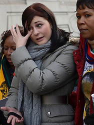 © Licensed to London News Pictures.06/12/2013. London, UK. A woman cries at the South African Embassy, London to pay tribute to late former South African president Nelson Mandela following his death in Johannesburg.Photo credit : Peter Kollanyi/LNP