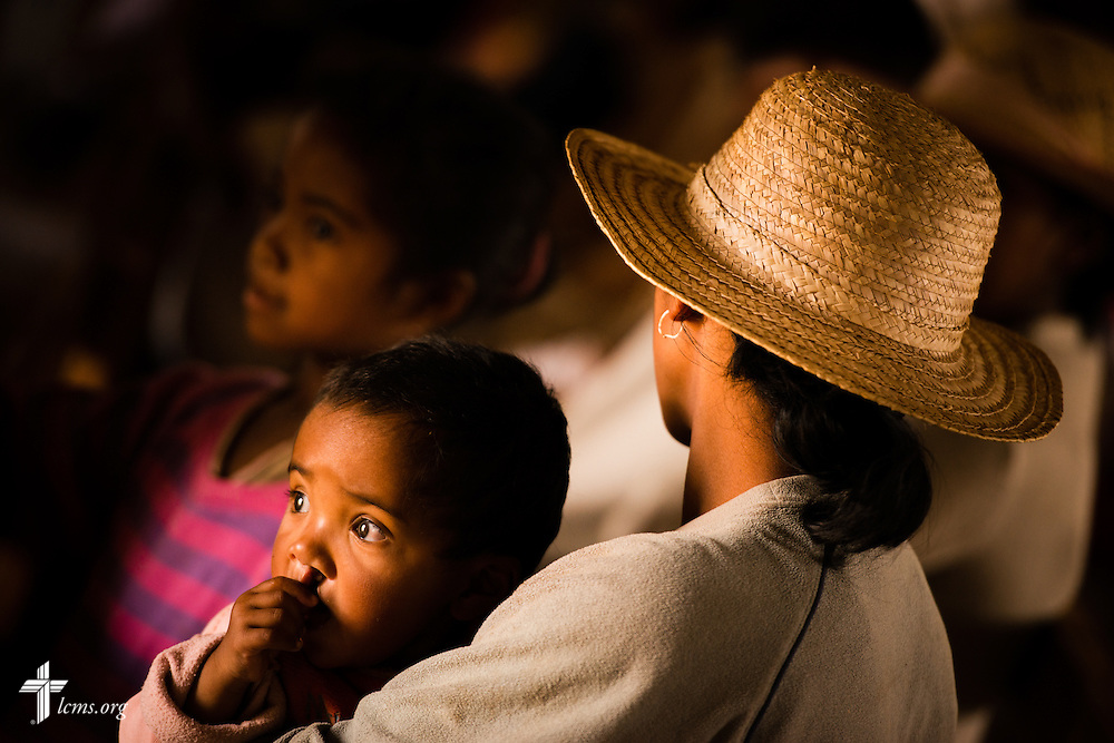 A woman and her child await a prescription at the Mercy Medical Team clinic on Saturday, Oct. 18, 2014, at a Fiangonana Loterana Malagasy (FLM) Lutheran church in Antsoantany, Madagascar. LCMS Communications/Erik M. Lunsford