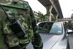 © Licensed to London News Pictures. 24/05/2014. Thai Army stop traffic following a Anti-Coup protest in Bangkok Thailand. The Royal Thai army announced a Military coup and have imposed a 10pm curfew.  Photo credit : Asanka Brendon Ratnayake/LNP