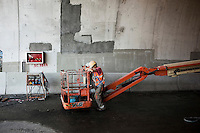 Bagnara, Italy - 18 July, 2012: Moussa Boukris, 43, a construction worker originally from Tunisia, rests at the end of the day after he finished working on the construction site of the Canalello bridge on 18 July, 2012, in Bagnara, Italy. The Autostrada A3 Salerno-Reggio Calabria is a motorway in the south of Italy, which runs from Salerno to Reggio Calabria via Salerno. Due to its notorious poor conditions of maintenance, and its difficult route, the motorway has been often taken as a symbol of the backwardness and economical problems of southern Italy.