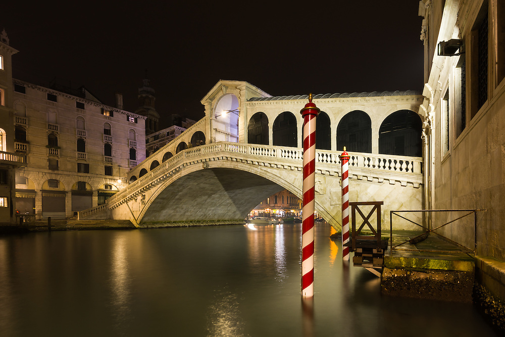 View of the Rialto Bridge at night in Venice, Italy