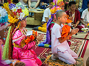 "06 APRIL 2015 - CHIANG MAI, CHIANG MAI, THAILAND: Boys pray with their monk's robes during their ordination on the last day of the three day long Poi Song Long Festival in Chiang Mai. The Poi Sang Long Festival (also called Poy Sang Long) is an ordination ceremony for Tai (also and commonly called Shan, though they prefer Tai) boys in the Shan State of Myanmar (Burma) and in Shan communities in western Thailand. Most Tai boys go into the monastery as novice monks at some point between the ages of seven and fourteen. This year seven boys were ordained at the Poi Sang Long ceremony at Wat Pa Pao in Chiang Mai. Poy Song Long is Tai (Shan) for ""Festival of the Jewel (or Crystal) Sons.   PHOTO BY JACK KURTZ"