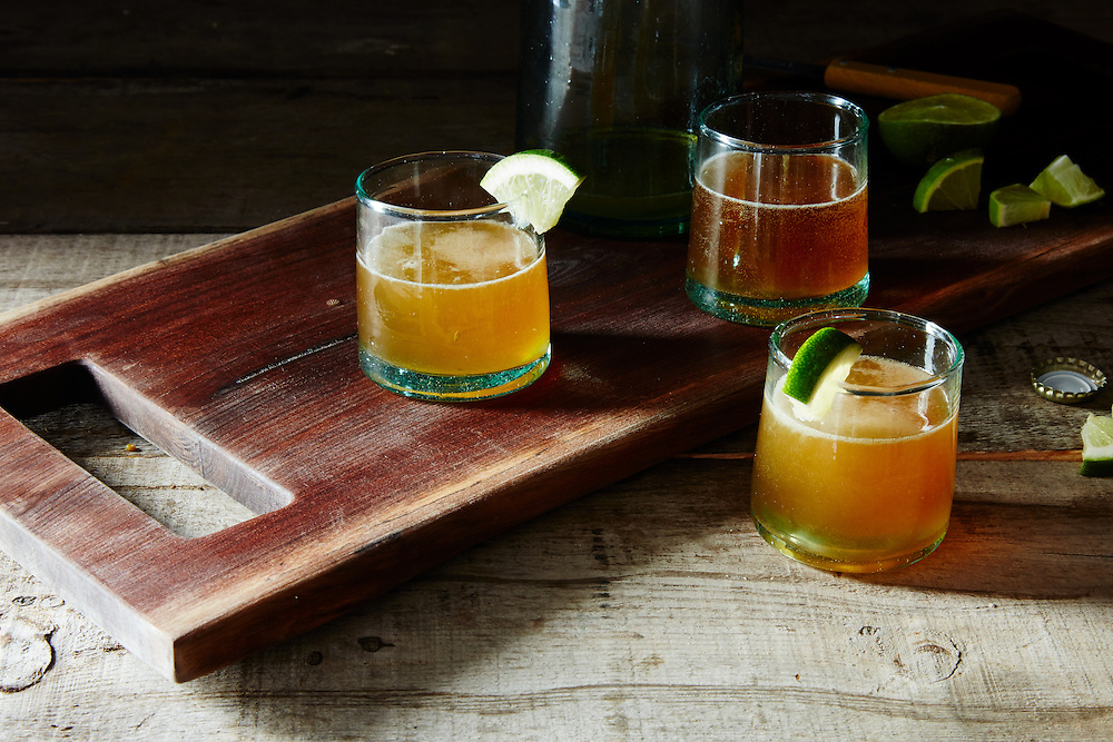 beer and mezcal cocktail with lime agave and dashes of hot sauce and worcestershire