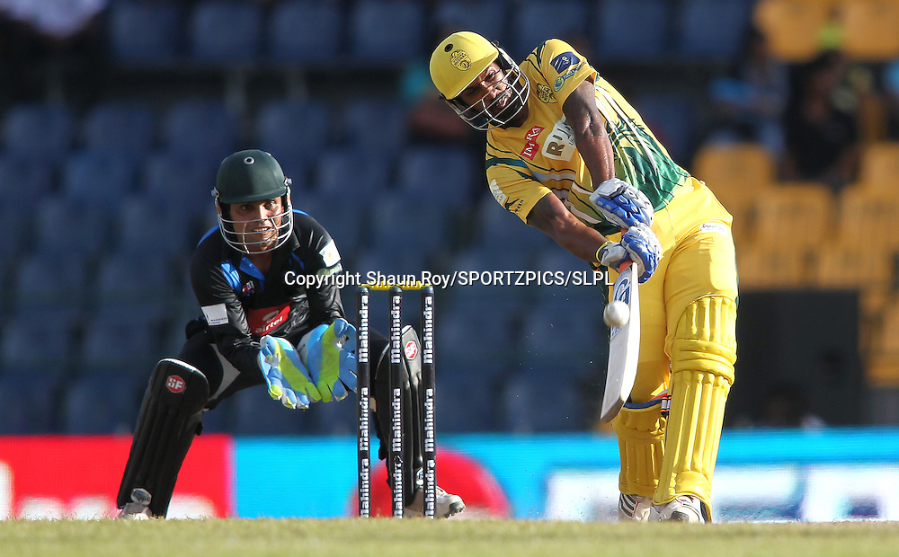 Chamara Kapugedara of Uthura Rudras attacks a delivery during match 3 of the Sri Lankan Premier League between Uthura Rudras and Wayamba United held at the Premadasa Stadium in Colombo, Sri Lanka on the 11th August 2012<br />  <br /> Photo by Shaun Roy/SPORTZPICS/SLPL