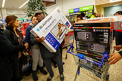 © Licensed to London News Pictures. 26/11/2015. London, UK. Black Friday shoppers buying reduced televisions in a Tesco Extra store in Edmonton, north London on Friday, 27 November 2015. Photo credit: Tolga Akmen/LNP