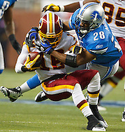 Detroit Lions running back Maurice Morris (28) tackles Washington Redskins wide receiver Brandon Banks (16) in the first half of NFL football game in Detroit, Sunday, Oct. 31, 2010. (AP Photo/Rick Osentoski)