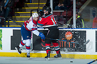 KELOWNA, CANADA - NOVEMBER 14: Kole Lind #16 of the Kelowna Rockets checks Matthew Robertson #22 of the Edmonton Oil Kings at the boards during first period on November 14, 2017 at Prospera Place in Kelowna, British Columbia, Canada.  (Photo by Marissa Baecker/Shoot the Breeze)  *** Local Caption ***