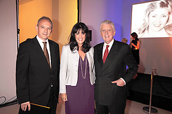 GRAHAM BOYES and GAIL REBUCK winner of the Veuve Clicquot Business Woman Award 2009 and LORD POWELL at the presentation of the Veuve Clicquot Business Woman Award 2009 hosted by Graham Boyes MD Moet Hennessy UK and presented by Sir Trevor Macdonald at The Saatchi Gallery, Duke of York's Square, Kings Road, London SW1 on 28th April 2009.