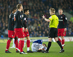 CARDIFF, WALES - Tuesday, February 1, 2011: Cardiff City's Jay Bothroyd lies injured as Reading's players surround the Referee in frustration during the Football League Championship match at the Cardiff City Stadium. (Photo by Gareth Davies/Propaganda)