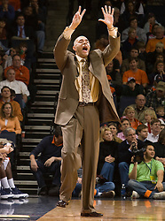 Virginia head coach Dave Leitao signals to his team during the Auburn game.  The Auburn Tigers defeated the Virginia Cavaliers 58-56 at the University of Virginia's John Paul Jones Arena  in Charlottesville, VA on December 20, 2008.  (Special to the Daily Progress / Jason O. Watson)