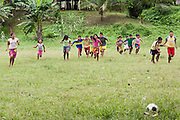 Embera school children enjoying the government built soccer field. Villa Keresia, Panama.